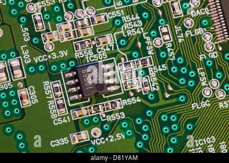 Closeup detail of IC chip on circuit board - Stock Photo