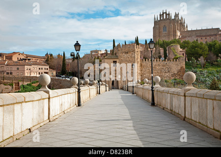 Toledo - Outlook form San Martin s bride or Puente de san Martin to Moanastery of saint John of the King in morning - Stock Photo