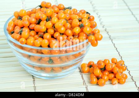Sea-buckthorn berries in glass bowl Stock Photo