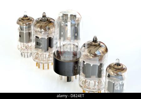 Old vacuum radio tubes isolated on white background - Stock Photo