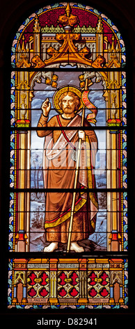 MADRID - MARCH 10: Saint John the Baptist from windowpane of church San Jeronimo el Real on March 10, 2013 in Spain. - Stock Photo