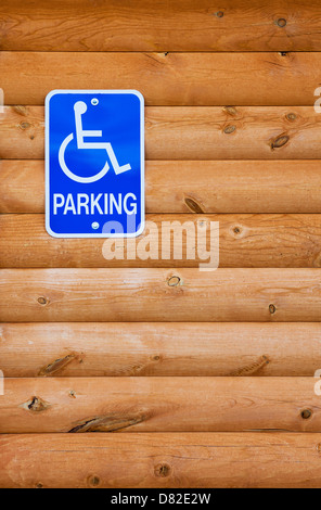 Traditional handicapped parking sign for the disabled on a wooden wall, Utah - Stock Photo