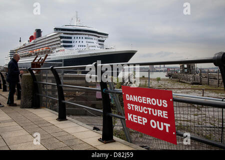 Liverpool, UK 17th May, 2013. Old dock & Dangerous structure sign at the Cruise Liner Terminal where the Passenger - Stock Photo