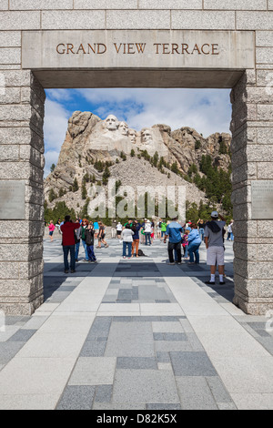 Tourists Viewing Mount Rushmore from Grand View Terrace, Black Hills, South Dakota - Stock Photo