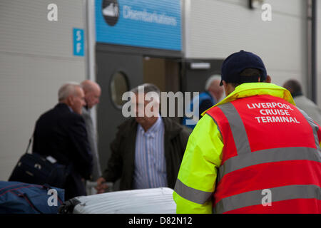 Liverpool, UK 17th May, 2013. Loading suitcases at Cruise Liner Terminal where the Passenger ship registered in - Stock Photo