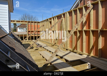 Detached house new bedroom extension first floor joist & timber frame plywood panels await new roof works England - Stock Photo