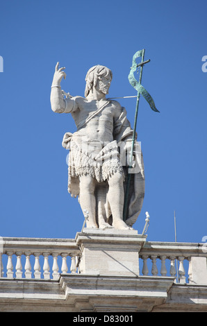 Statue of John the Baptist on the top of Saint Peter Basilica facade. Rome, Italy - Stock Photo