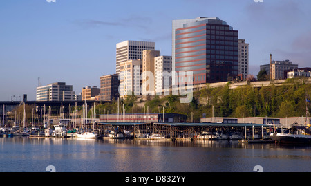 Sunrise appears as the light hits the Tacoma Washington waterfront in the Northwest United States - Stock Photo