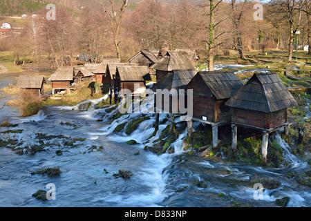 Miniature watermills on river Pliva, Jajce, Bosnia and Herzegovina - Stock Photo