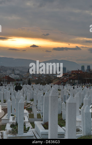 Graves of civil war victims in Martyrs' Memorial Cemetery Kovaci with Alija Izetbegovic tomb, Sarajevo, Bosnia and - Stock Photo