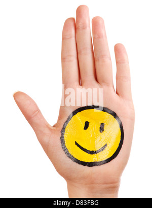 Palm with a happy smiling smiley icon painted on it isolated on white background - Stock Photo