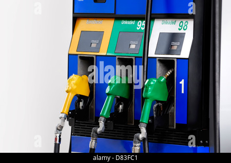 Gas pump nozzles with diesel, 95 and 98 petrol closeup - Stock Photo