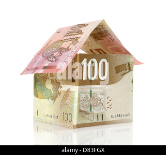Model of a house made from Canadian dollar bills closeup Mortgage, Investment, Property insurance, Property tax, - Stock Photo