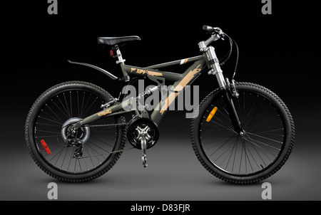 MTB sport 21-speed dual suspension mountain bicycle Isolated on black background with a clipping path - Stock Photo