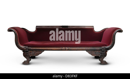 Antique victorian wooden dark red sofa isolated with clipping path on white background - Stock Photo