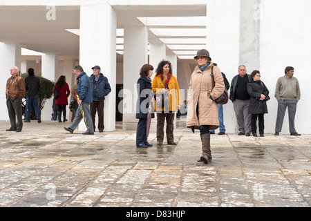 Nossa Senhora da Piedade church courtyard with group of people waiting Loulé Algarve Portugal Mediterranean Europe - Stock Photo