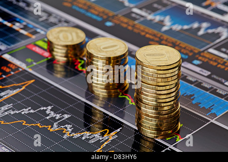 Uptrend stacks coins,on the financial stock charts as background. Selective focus - Stock Photo