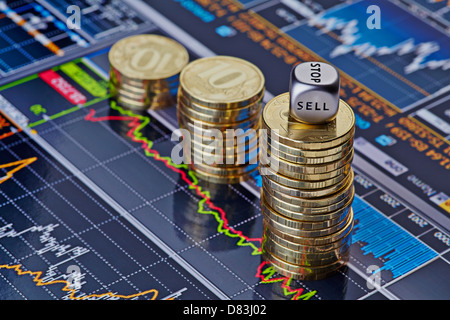 Uptrend stacks of golden coins and the dices cube with the word SELL. Financial chart as background. Selective focus - Stock Photo