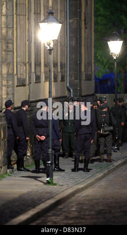 Extras costumed as soldiers of the German Wehrmacht, the armed forces of the Thurd Reich, are visible at a film - Stock Photo