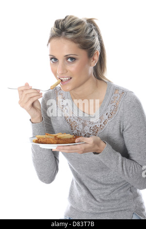Model Released. Young Woman Eating Fish and Chips - Stock Photo