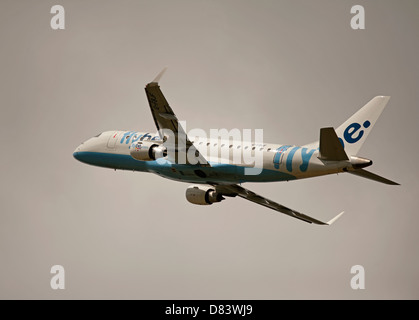Twin engined Embraer ERJ-190-2000-195LR Flybe Civil Airliner departing Inverness  Airport Highland Scotland  SCO - Stock Photo