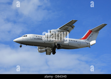 British Aerospace Avro RJ85 CityJet airline on approach to London City Airport - Stock Photo