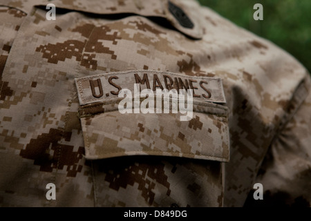 US Marine Corps tape on combat utility uniform - Stock Photo