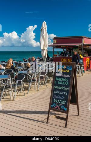 Outdoor cafe on the beach at Barceloneta, Barcelona, Catalonia, Spain - Stock Photo