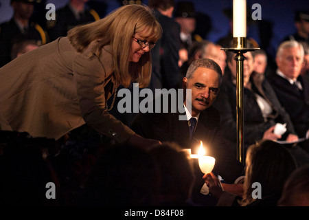 US Attorney General Eric Holder lights his candle during the National Law Enforcement Officers Memorial Candlelight - Stock Photo