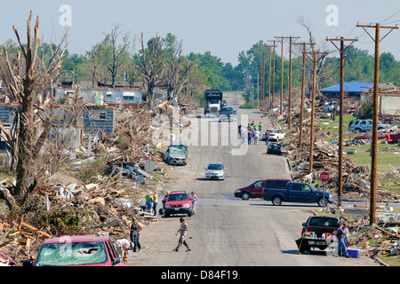 Volunteers and workers begin clean up of the debris fill the streets June 4, 2011 in Joplin, MO. The town was destroyed by an EF-5 tornado on May 22, 2011 killing 189 people.
