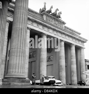 March 1959, 'Volkspolizei' East German police officers controlling cars at Brandenburg Gate, East Berlin, Germany, - Stock Photo