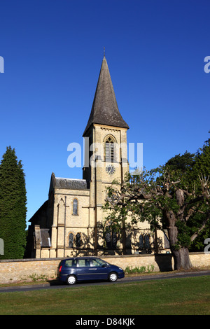 Car passing in front of St Peter's church , Southborough Common , near Tunbridge Wells , Kent , England - Stock Photo