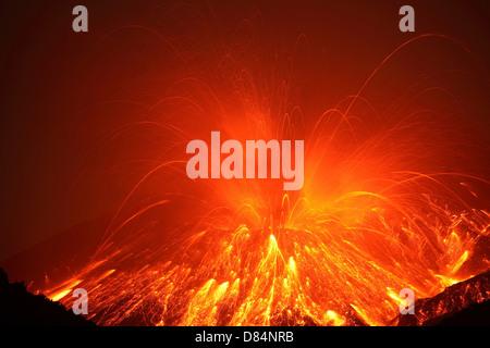 Powerful night time explosive eruption of Sakurajima volcano, Japan. - Stock Photo
