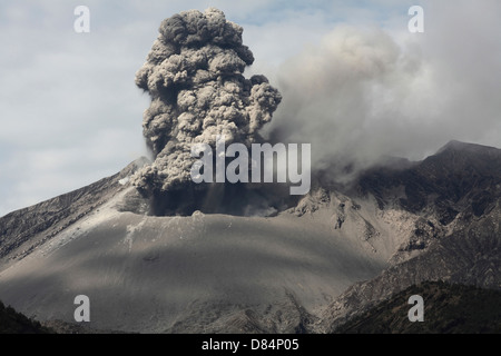 February 25, 2013 - Explosive eruption of Sakurajima volcano, Japan. Ash cloud rising from Showa crater. - Stock Photo
