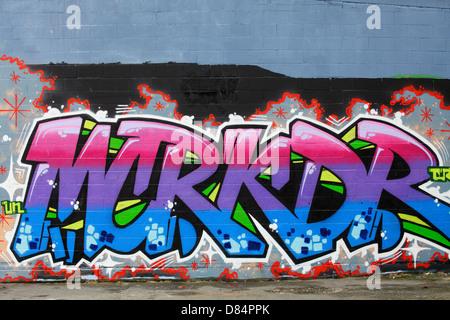 Colorful graffiti on side wall of building-Victoria, British Columbia, Canada. - Stock Photo