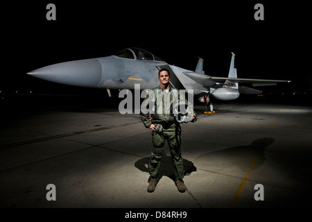 A U.S. Air Force pilot stands in front of a McDonnell Douglas F-15C aircraft. - Stock Photo