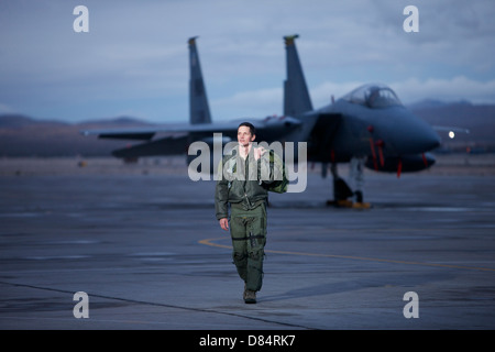 A U.S. Air Force pilot walking away from a McDonnell Douglas F-15C aircraft. - Stock Photo