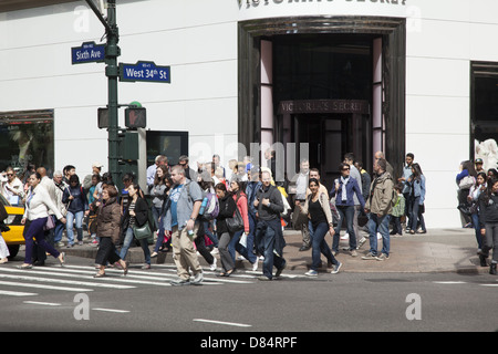 The always busy corner of 34th Street and 6th Avenue across from Macy's Dept. Store in Manhattan. - Stock Photo