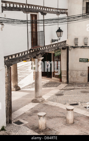 Porticoed entrance to the Plaza Mayor in the little town Chinchon, New Castille, Spain - Stock Photo