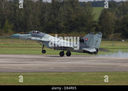 A Slovak Air Force MiG-29AS Fulcrum landing on the runway at an airfield in the Czech Republic. - Stock Photo