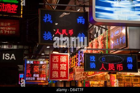 HONG KONG - DECEMBER 05: Mongkok at night on December 05, 2010 in Hong Kong, China. Mongkok in Kowloon is one of - Stock Photo