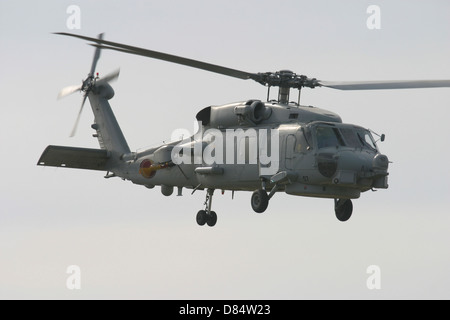 An SH-60B Seahawk of the Spanish Navy in flight over Rota, Spain. - Stock Photo