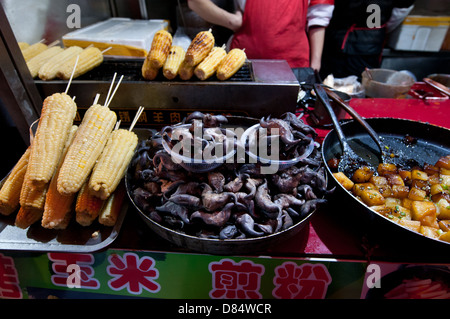 fried corn cobs, tofu and Devil Pod (seed of Trapa bicornis), food stall at Wangfujing Snack Street in Dongcheng, - Stock Photo