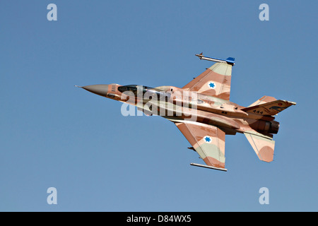 An F-16I Sufa of the Israeli Air Force in flight over Ramon Air Force Base, Israel. - Stock Photo