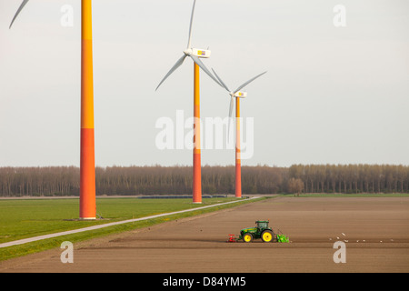 Colourful wind turbines in polders, reclaimed land near Almere, Flevoland, Netherlands. - Stock Photo