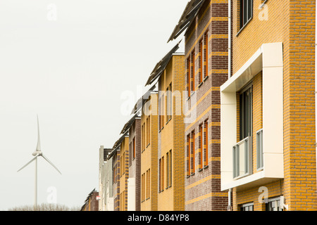 Houses with solar panels and a wind turbine in Sun City in Heerhugowaard, Holland,one of the greenest suberbs in - Stock Photo