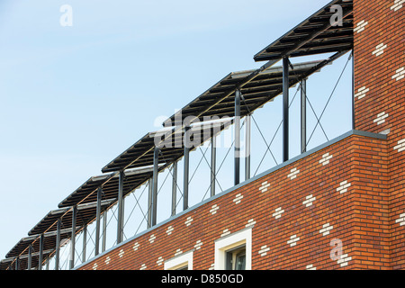 Houses in Almere with solar PV panels on the roof. - Stock Photo