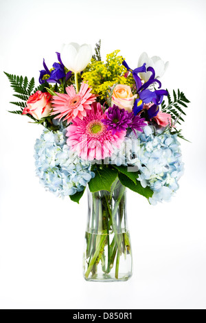 Fresh flower bouquet in a vase. - Stock Photo