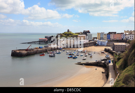 A view across the old harbour in Tenby, Pembrokshire, Wales, with the old and new lifeboat stations top left. - Stock Photo