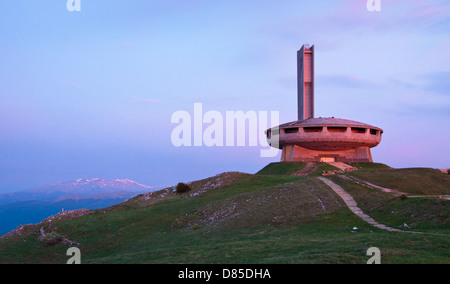 First morning light on the Buzludzha monument and the peaks of the Stara Planina mountains, central Bulgaria - Stock Photo